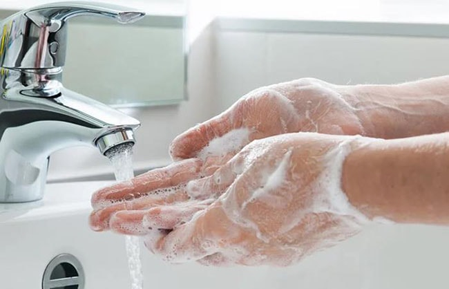 Washing hands with water and soap