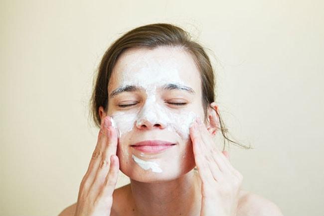 Woman using skincare cream