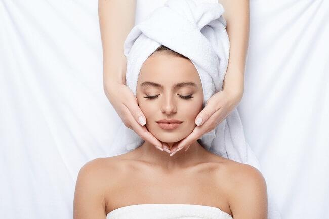 Woman having facial treatment